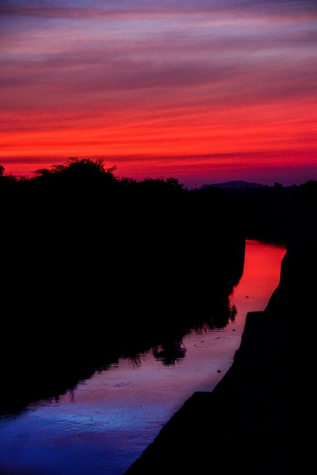 Red-sunset-hampi-kamalapura-canal